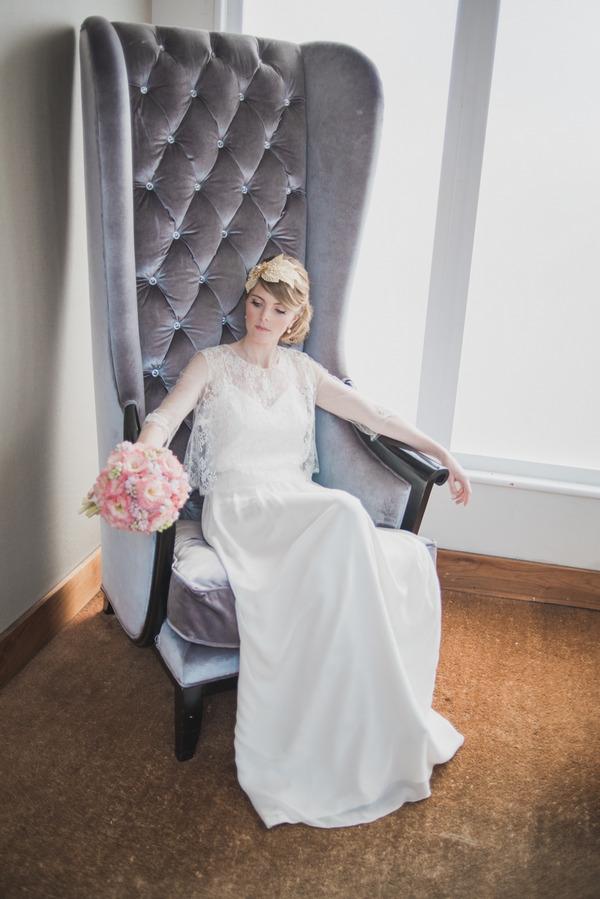 Bride sitting in grey chair