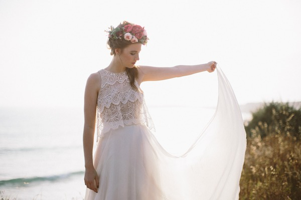 Bride holding out dress