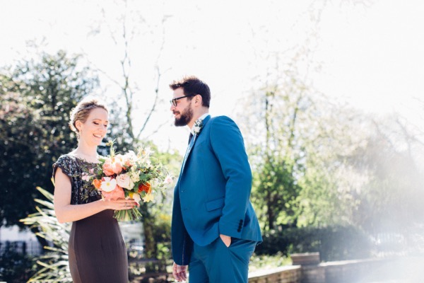 Bride with groom in blue suit