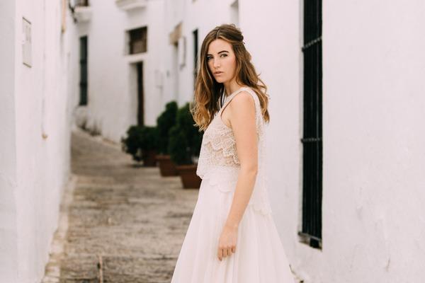 Bride standing in street in Spain