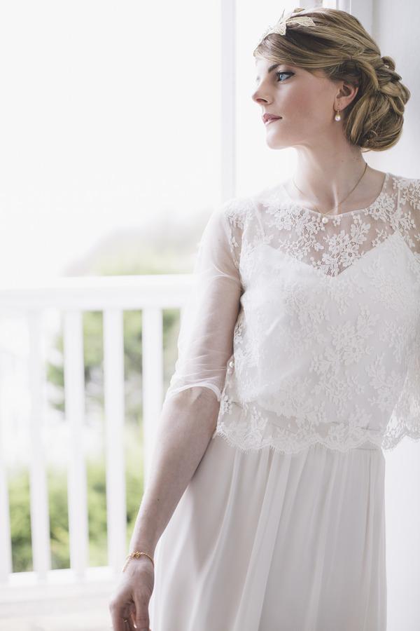 Bride wearing lace detailed wedding dress