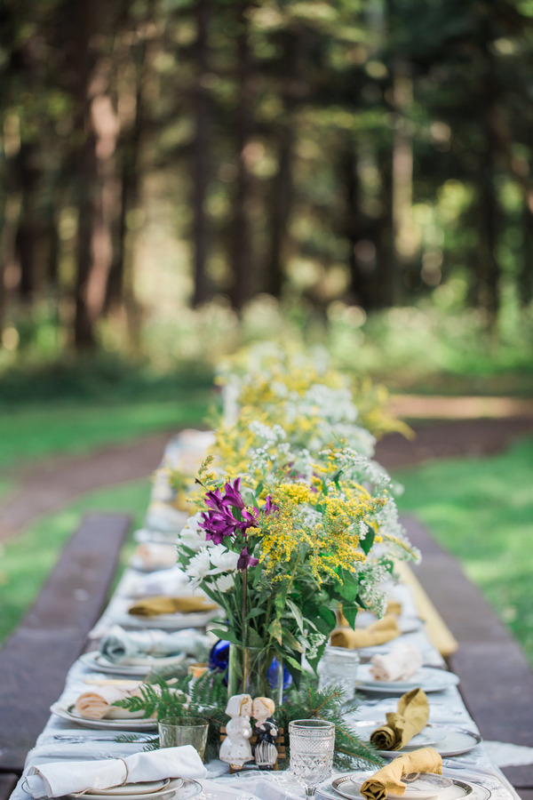 Flower centrepieces on long wedding table
