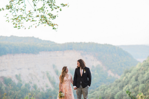 Bride and groom standing in front of view from Letchworth State Park