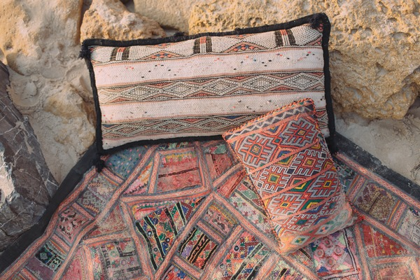 Cushions and blankets on beach in Spain