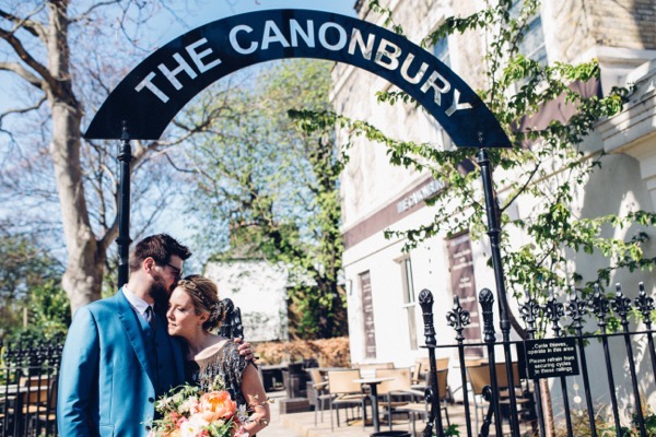 Bride and groom in front of The Canonbury sign