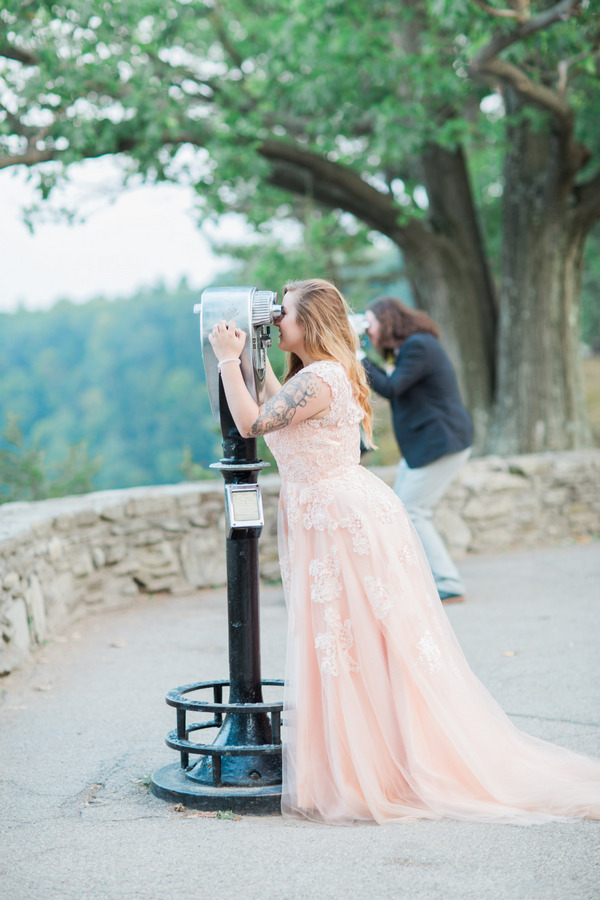 Bride and groom looking through binoculars at Letchworth State Park