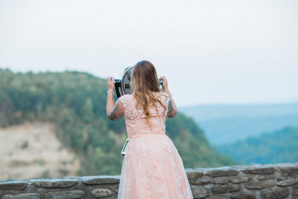 Back of bride looking through binoculars at Letchworth State Park