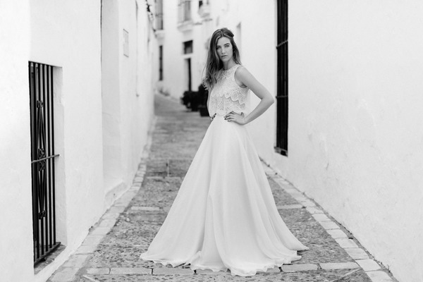 Boho bride with hands on hips