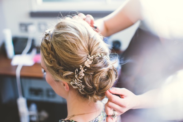 Bride's updo with plait and flowers