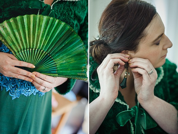 Bride putting on earrings and holding green fan