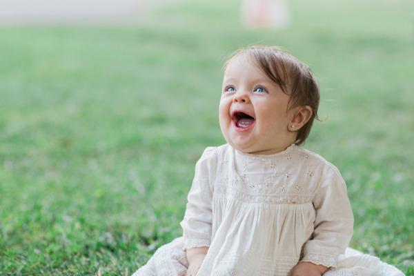Baby flower girl smiling