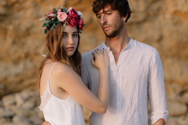 Groom looking at bride with flower crown