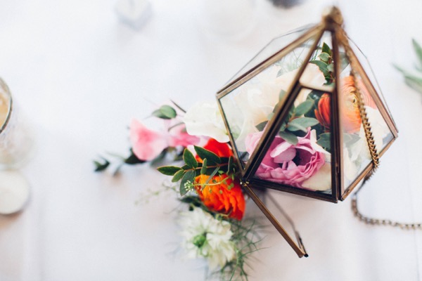 Lantern of flowers on wedding table