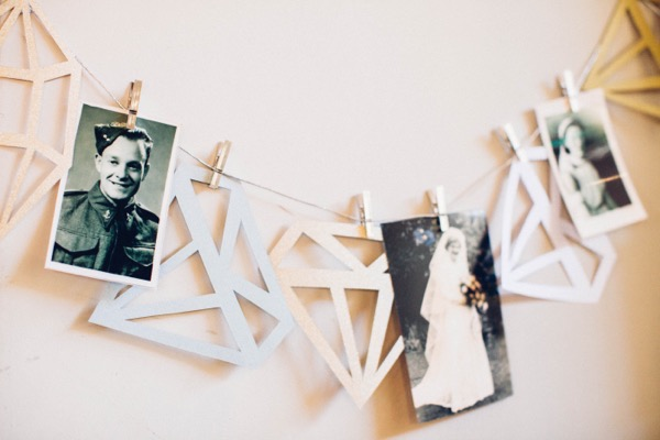 Old photographs hung on string