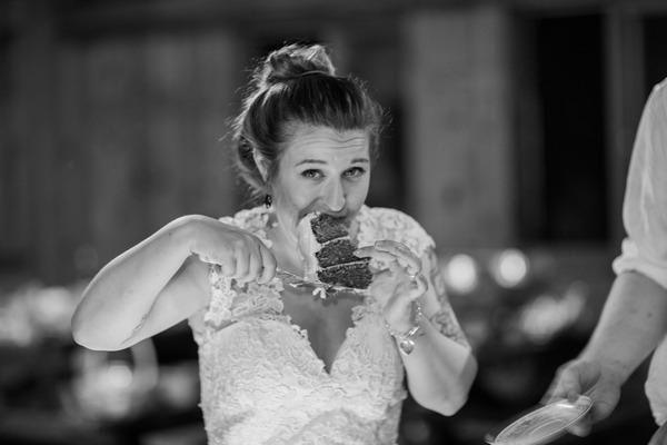 Bride eating wedding cake