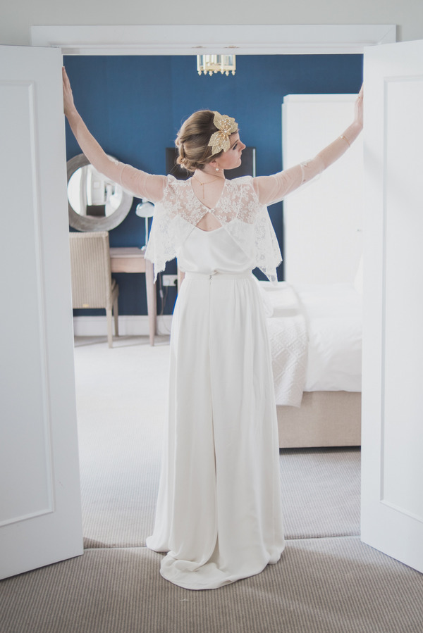 Bride standing with arms out