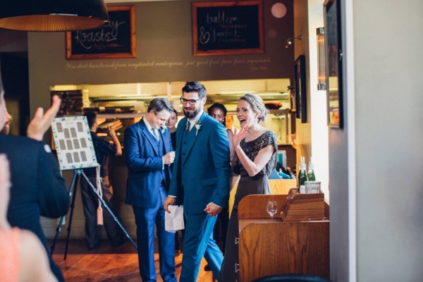 Bride and groom entering wedding breakfast at The Canonbury pub, Islington