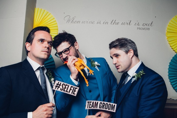Team groom in wedding photo booth