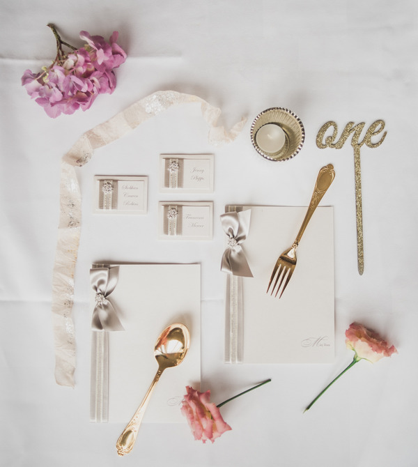 Pink and metallic wedding stationery and details