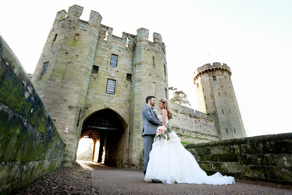 Briude and groom at entrance to Warwick Castle