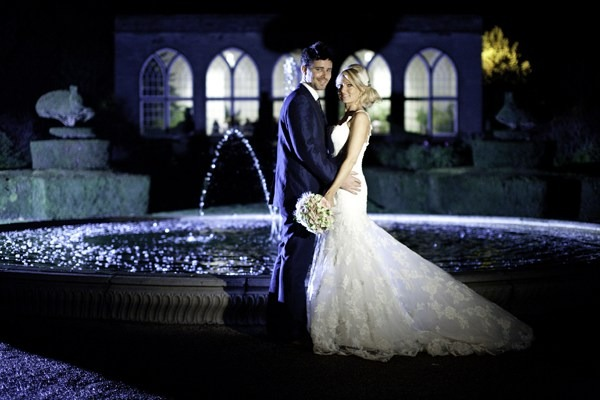 Bride and groom by fountain at Warwick Castle