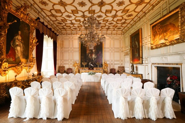 Wedding ceremony seating in State Dining Room at Warwick Castle