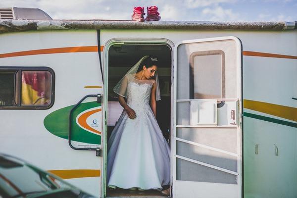 Bride leaving caravan for wedding