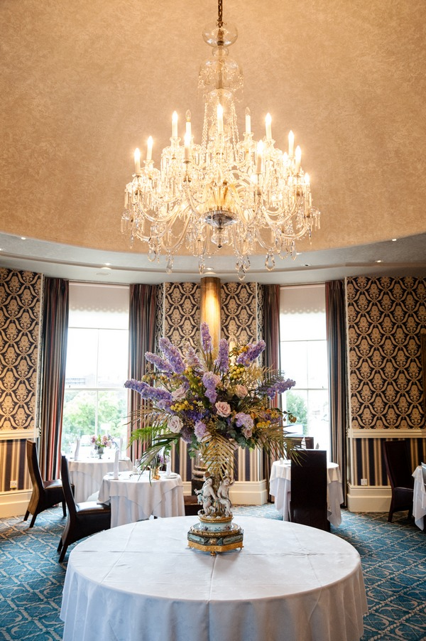 Large floral display under chandelier at The Duke of Cornwall Hotel