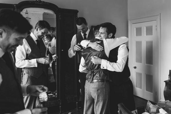 Groomsmen hugging