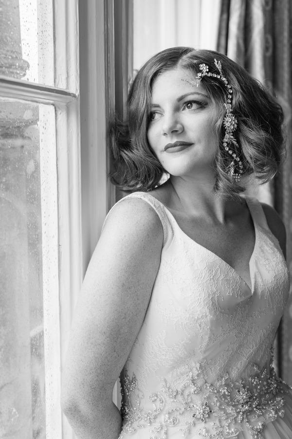 Bride leaning against window