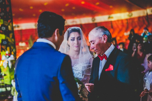 Bride with father and groom at altar