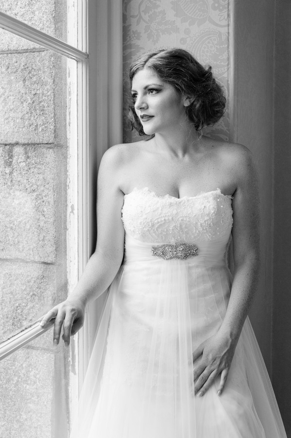 Bride standing by window at The Duke of Cornwall Hotel