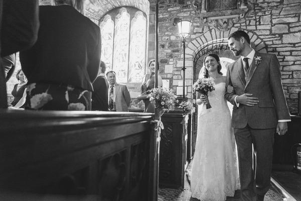 Bride entering church for wedding ceremony