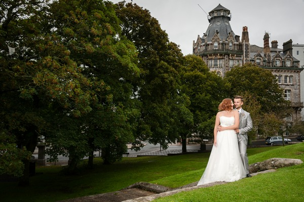Bride and groom in grounds of The Duke of Cornwall Hotel