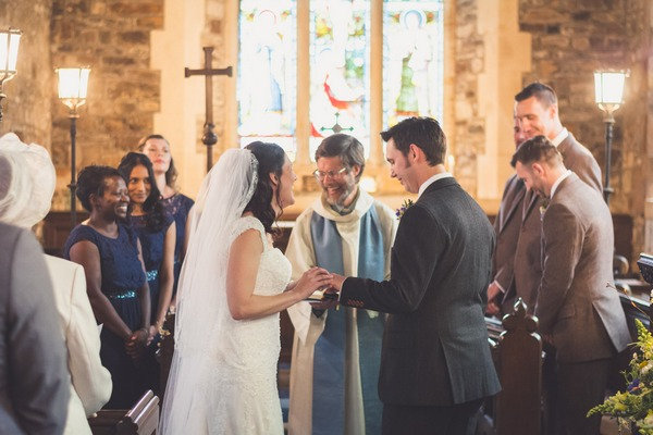 Bride laughing with vicar