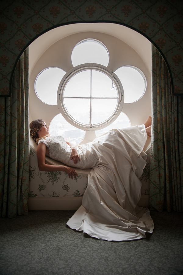 Bride laying in flower window at The Duke of Cornwall Hotel