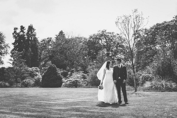 Bride and groom in grounds of Buckland House