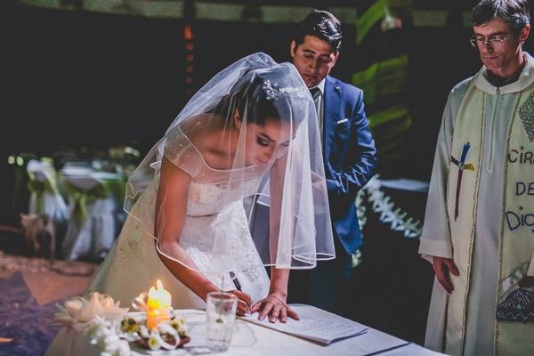Bride signing register