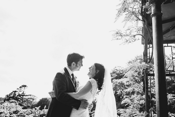 Bride laughing as groom leans in to kiss