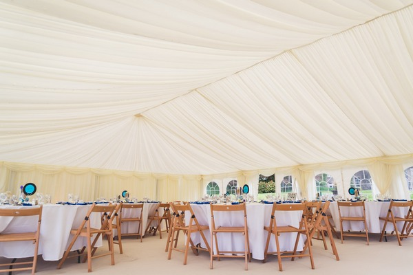 Wedding tables in marquee at Buckland House