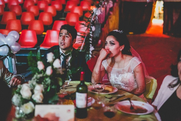 Bride and groom emotional at speech