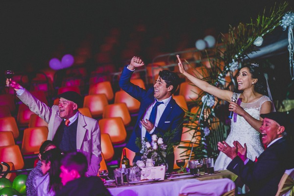 Bride and groom punching the air during speech