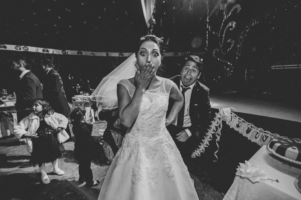 Bride with hand over mouth