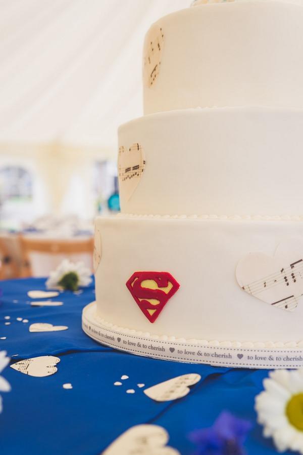 Superman S on side of wedding cake