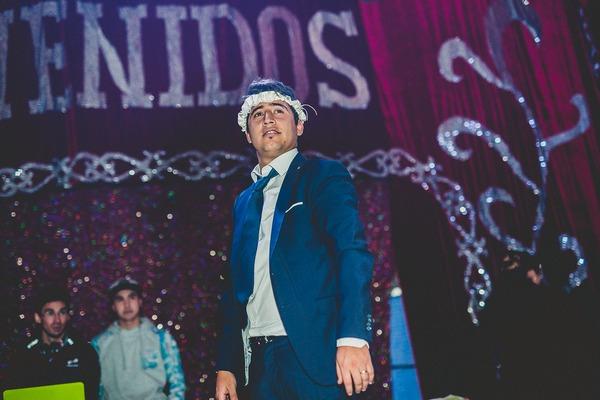 Groom with bride's garter on head
