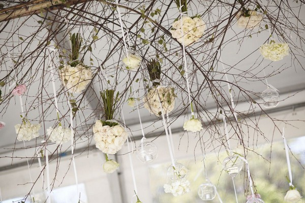 Flowers hanging from marquee ceiling