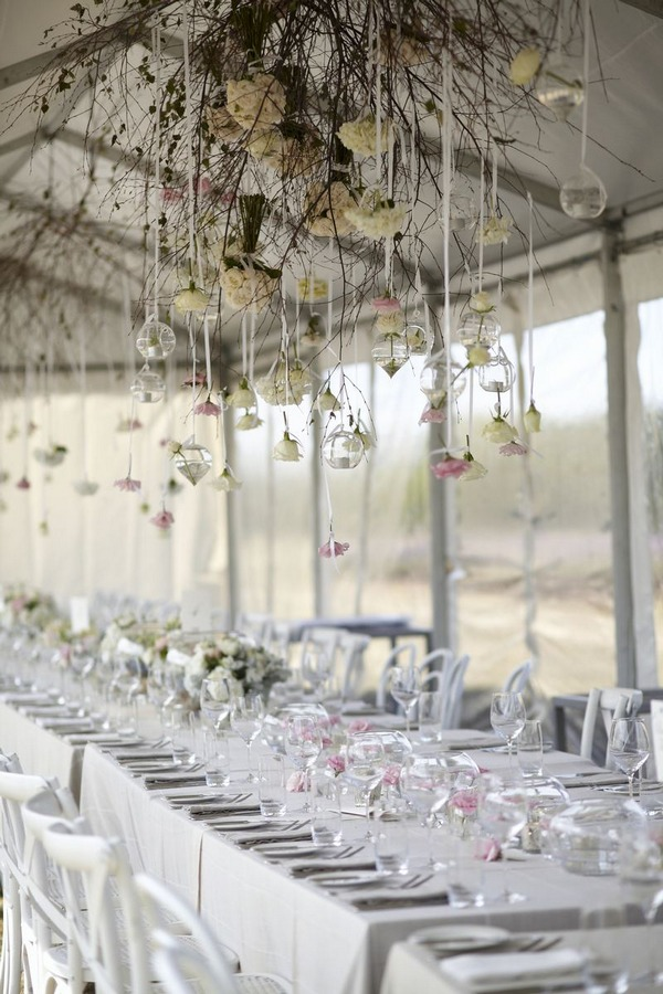 Marquee with flowers hanging from ceiling