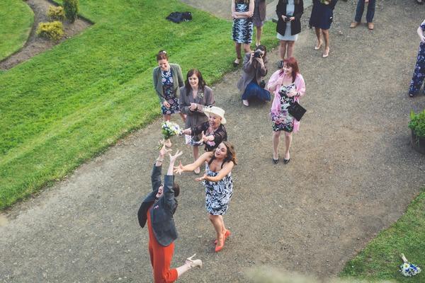 Lady catching bride's bouquet
