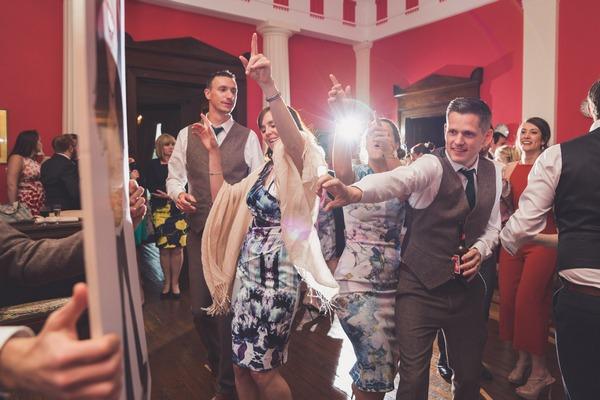 Guests dancing at wedding at Buckland House