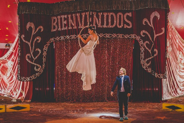 Bride and groom circus trapeze act
